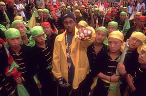 Rza surrounded by children